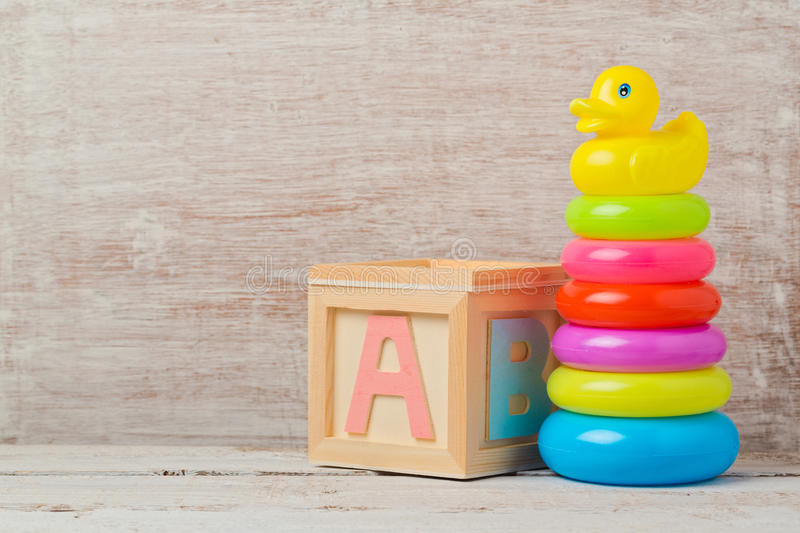 Baby toys on wooden table. Child development royalty free stock photos
