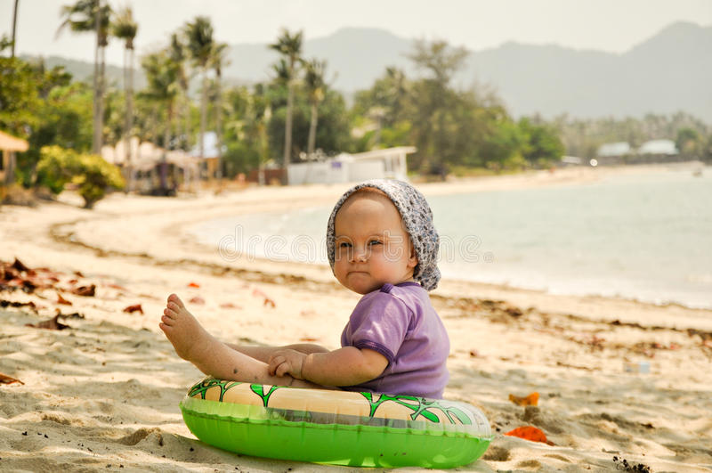 Baby on tropical beach. Baby girl on tropical beach in Thailand. Picture taken in March 2014 on Koh Pha Ngan island, Thailand