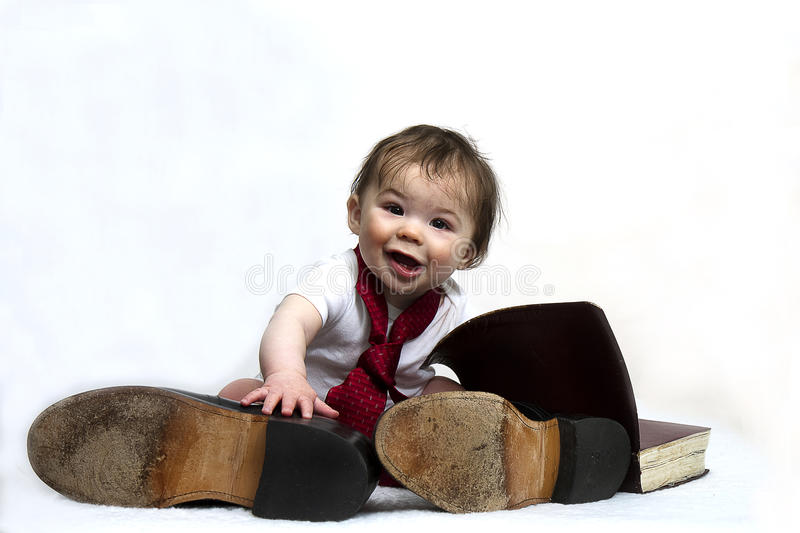 Baby Wearing Daddy's Shoes stock photography