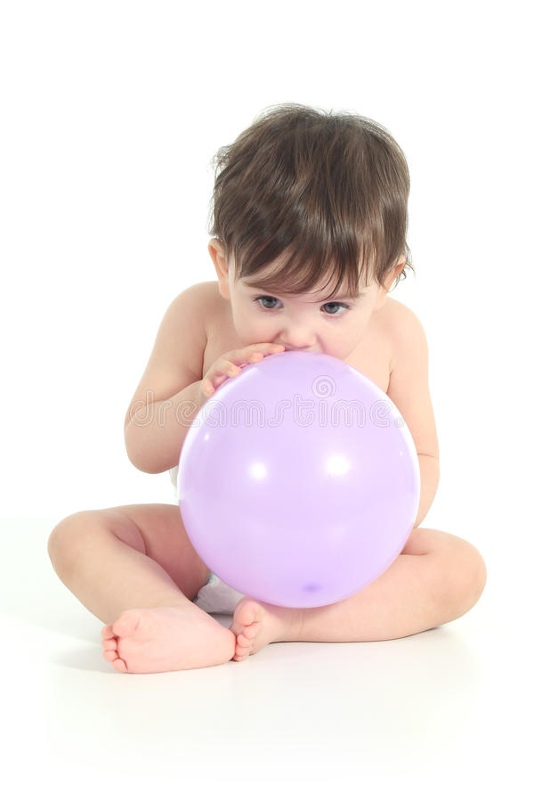 Free Baby Trying To Inflate A Balloon Stock Photo - 29078750