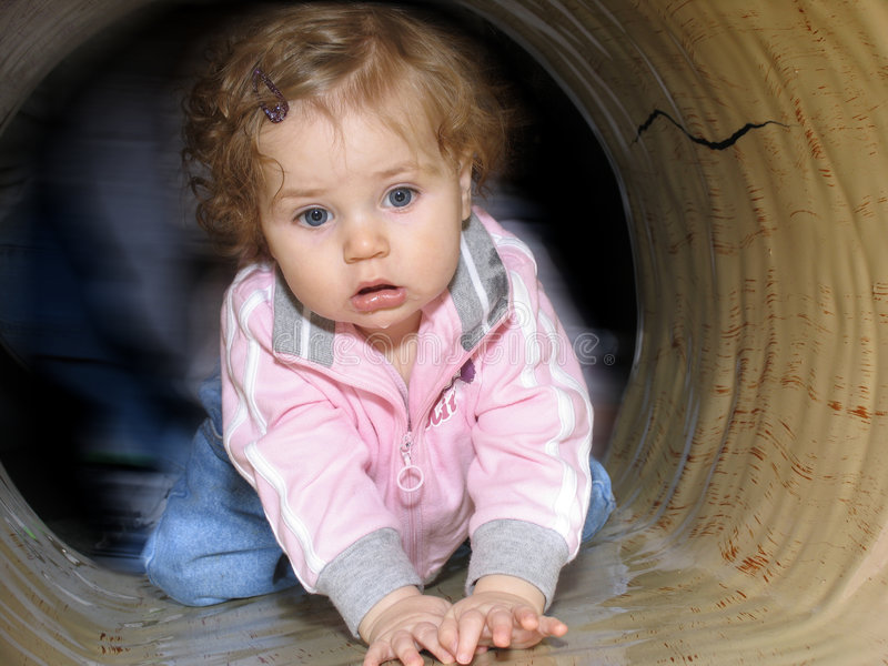 Download Baby in a tunnel stock photo. Image of kids, serious, child - 47118