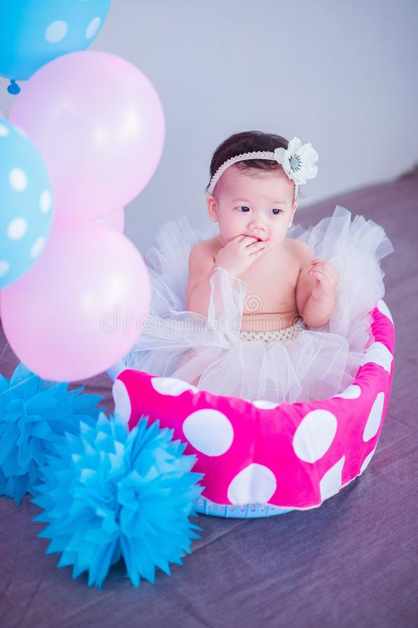 Baby in tutu with balloons stock images