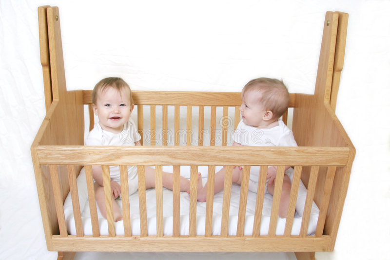 Baby Twins in Crib. Little Baby set of Twins in crib - only one baby royalty free stock images
