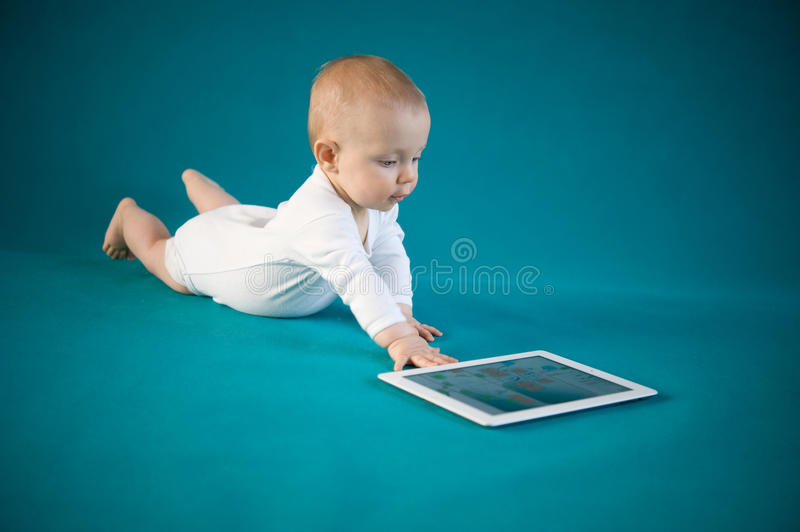 Download Baby using digital tablet stock photo. Image of crawling - 28392680