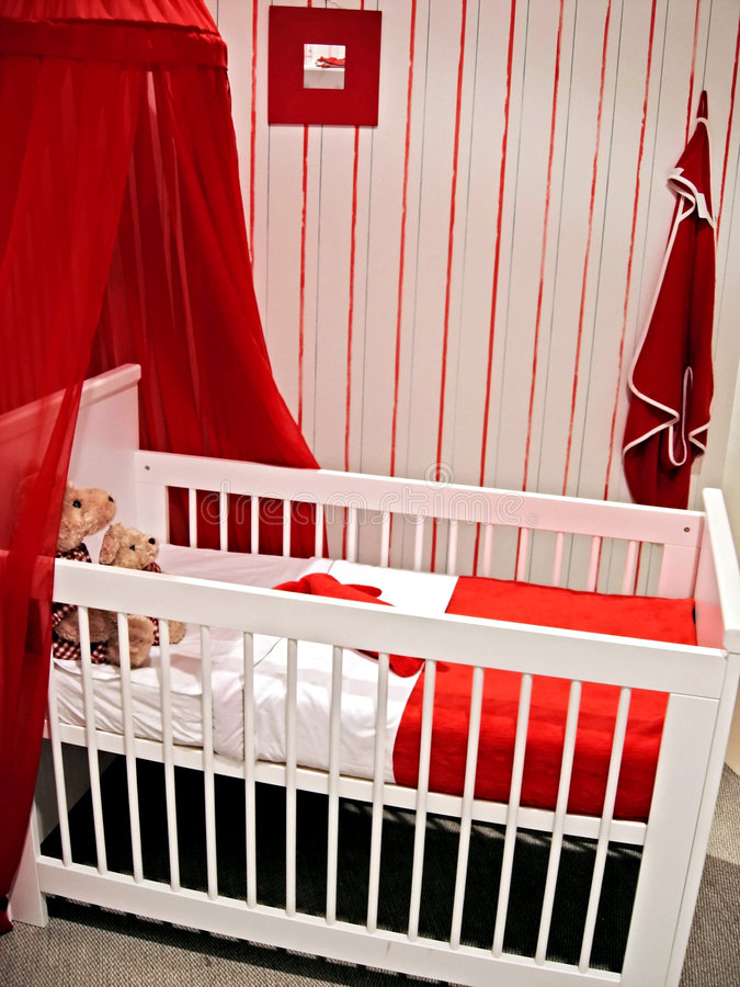 Baby waiting. Interior of child room in red color royalty free stock images