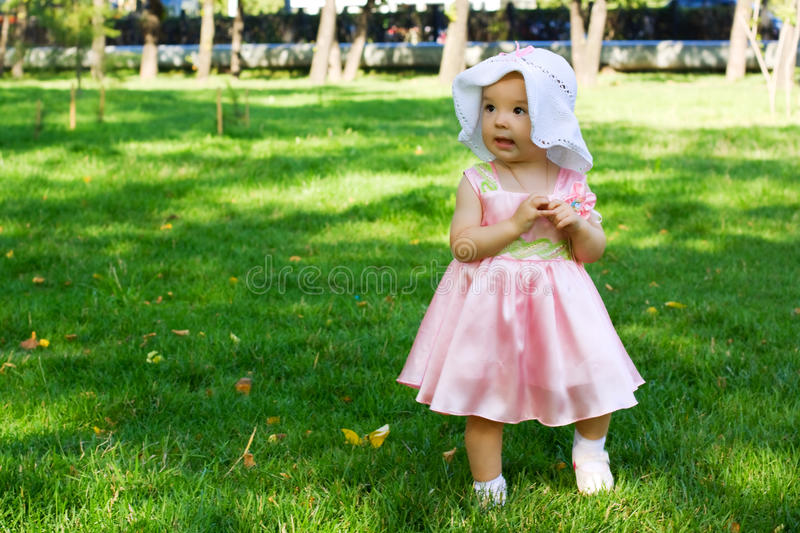 Baby walking in the park. royalty free stock photo