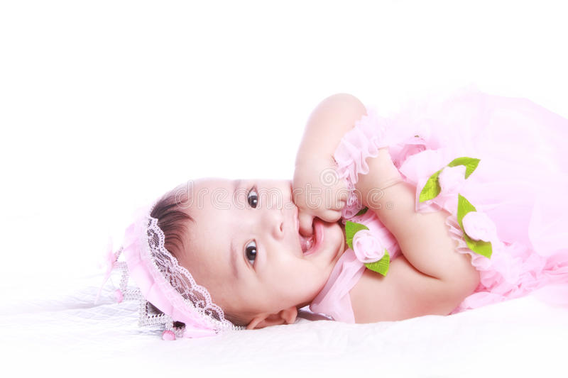 Baby Wearing Frock And Eating Finger Royalty Free Stock Photo