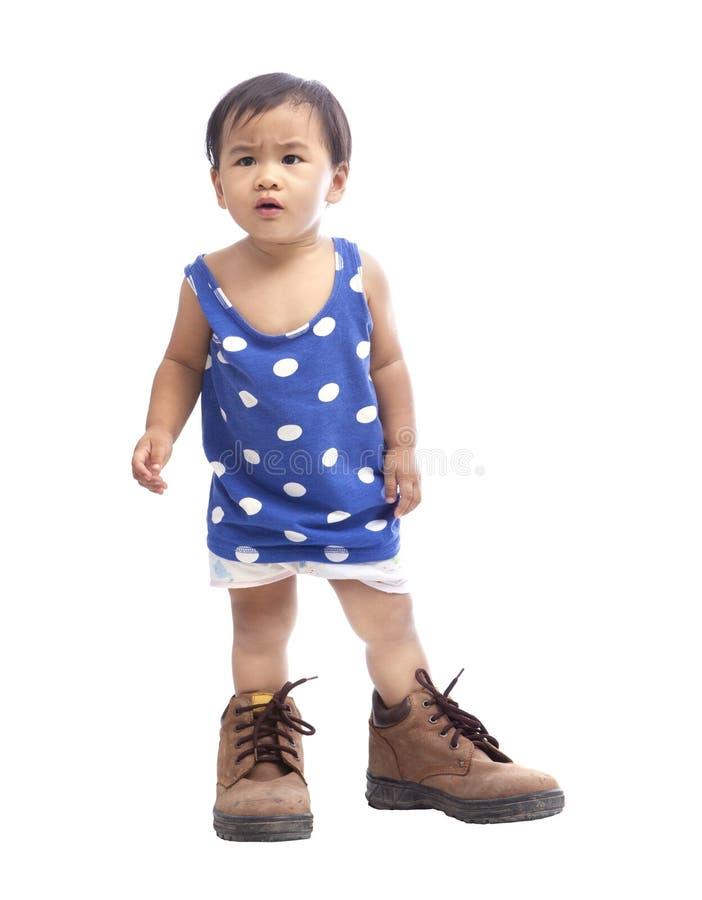 Baby wearing safety shoe isolated white stock photos