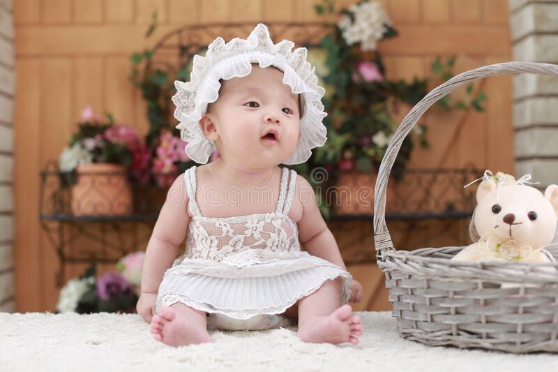 Baby in white dress and hat royalty free stock photos