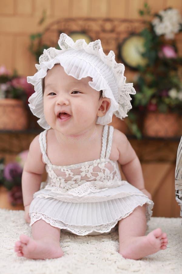 Baby in White Dress With White Headdress stock photos