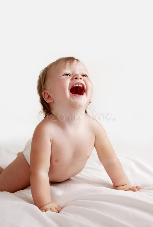 Download Baby In White Sheets Laughing Stock Photography - Image: 11555482