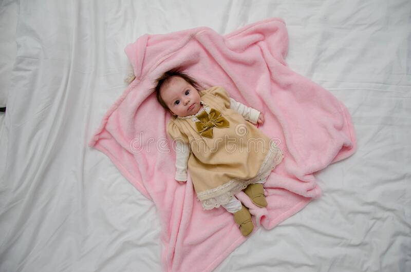 Baby In White And Yellow Dress On Pink Textile Free Public Domain Cc0 Image