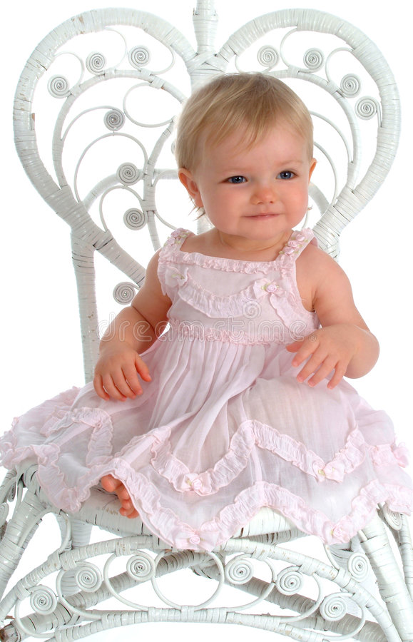 Baby in Wicker Chair stock photography
