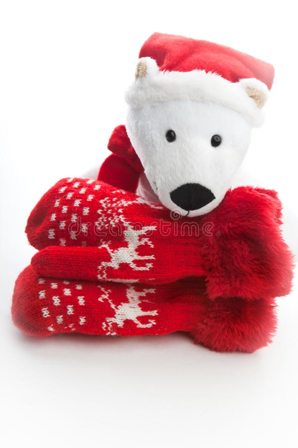 Baby winter clothes wool red mittens white background. Studio quality white background red wool mittens baby winter clothes bear Santa Claus Christmas gift stock photos