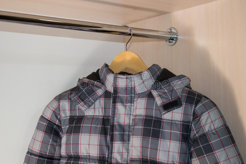 Baby winter jacket on the hanger,The house hangs in the closet of the boy`s winter jacket royalty free stock image