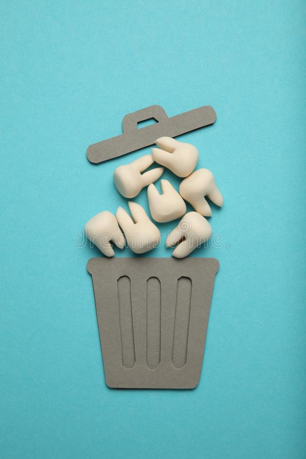 Baby and wisdom teeth in garbage can. Removal of teeth in children and adults, concept.  stock photography