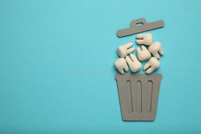 Baby and wisdom teeth in garbage can. Removal of teeth in children and adults, concept.  stock photos