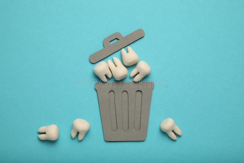 Baby and wisdom teeth in garbage can. Removal of teeth in children and adults, concept.  stock images
