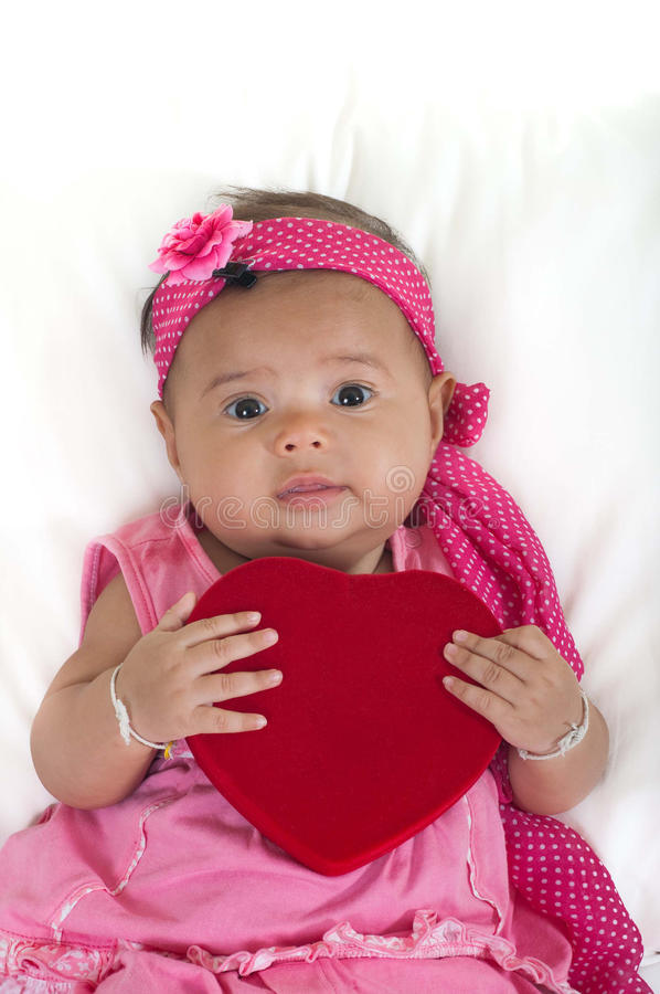 Free Baby With Heart Pillow On A Bed Stock Image - 21154431