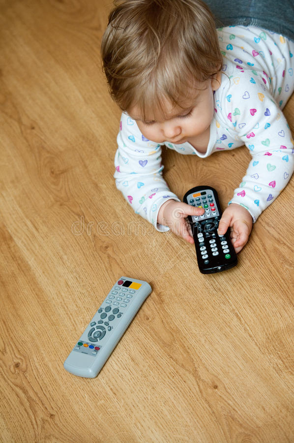 Free Baby With Remote Controls Stock Photos - 18873763