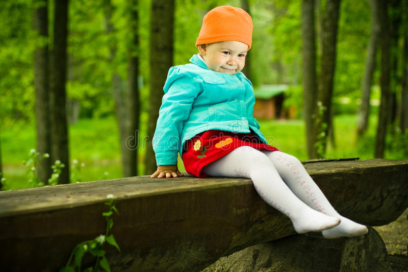 Baby on a wooden bench royalty free stock image