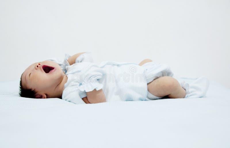 Baby Yawn stock photo