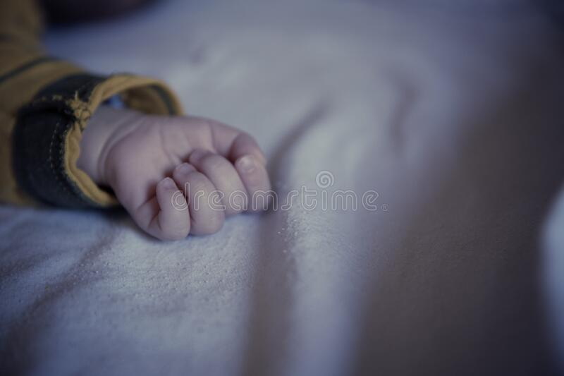 Baby In Yellow And Black Long Sleeved Shirt Lying On White Textile Free Public Domain Cc0 Image