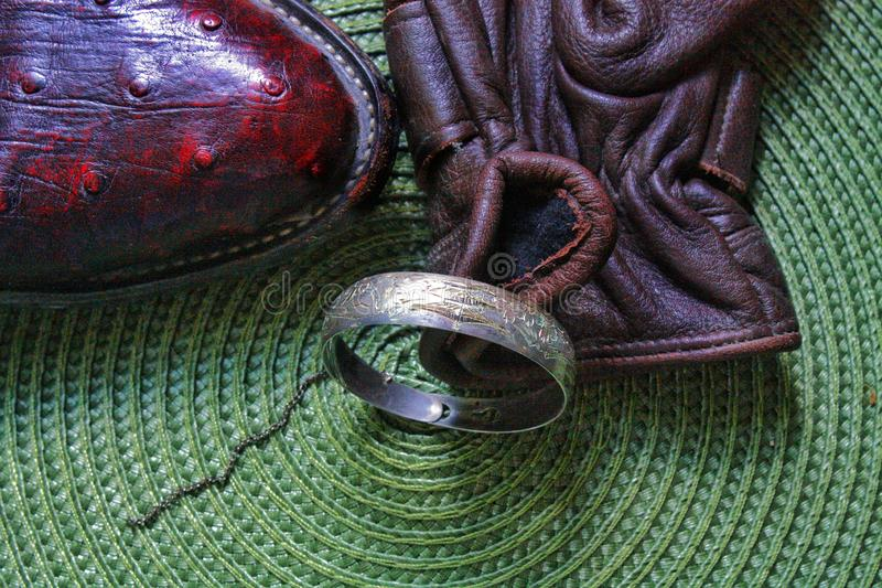 Baby you& x27;re the one .crocodile skin boot glove ring. stock photo