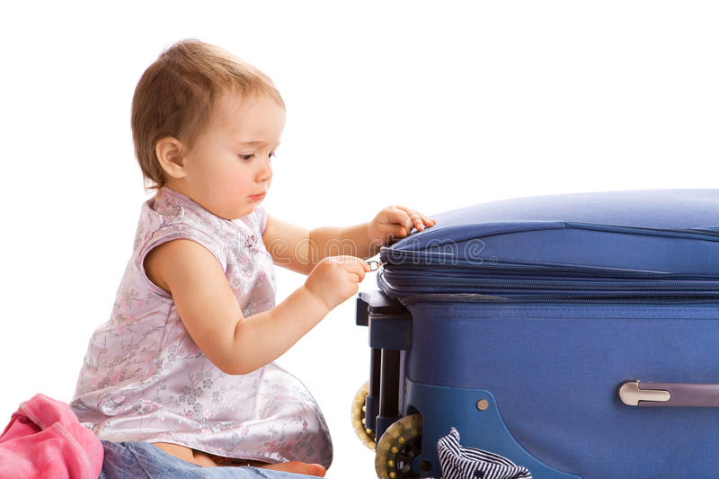 Baby zipping suitcase stock images