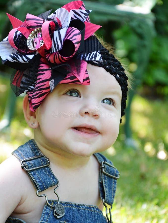Babygezicht met Boog stock foto
