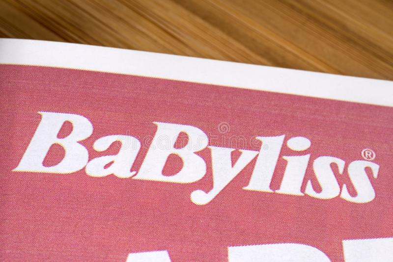 Babyliss Brand Logo. London, UK - December 5th 2019: Close-up of the Babyliss brand logo in a product catalogue.  Babyliss is owned by Conair Corporation - a US stock images