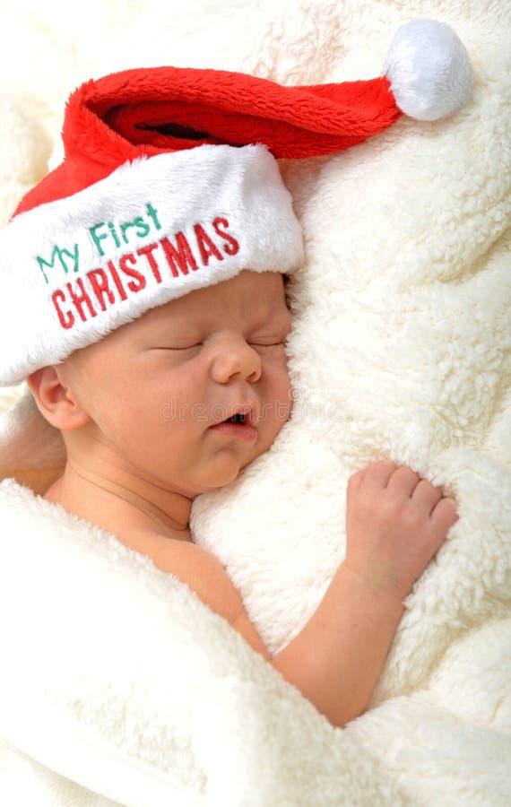 Babys första jul royaltyfri fotografi