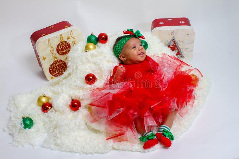 Babys första julphotoshoot arkivbild