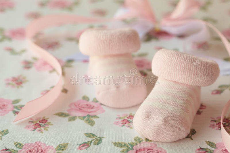 Babys flickaskor arkivfoton
