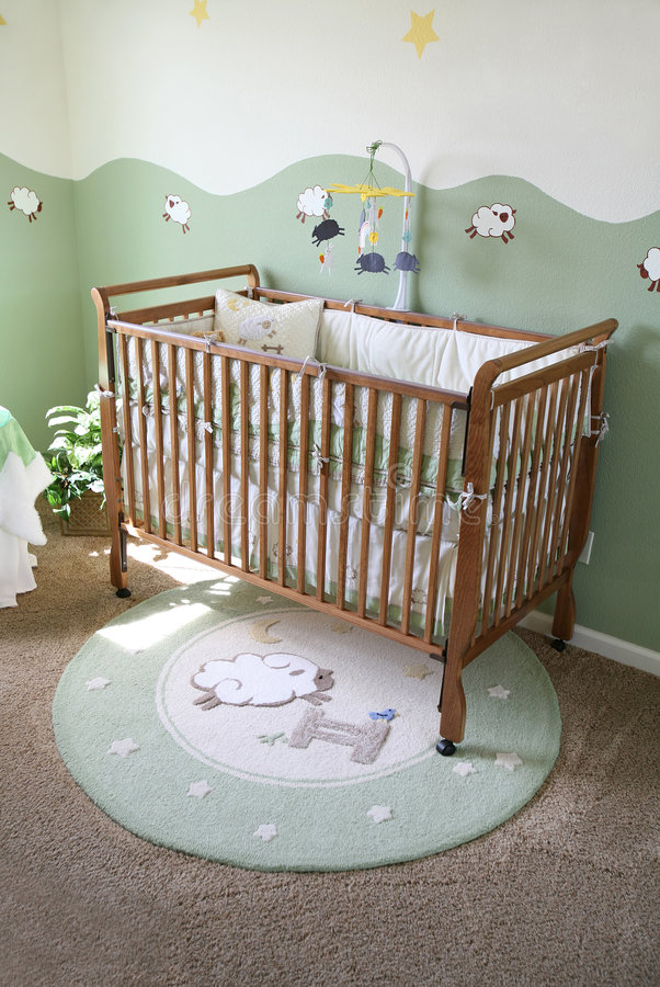 Babys Room. A crib in a baby room inteior inside an upscale home