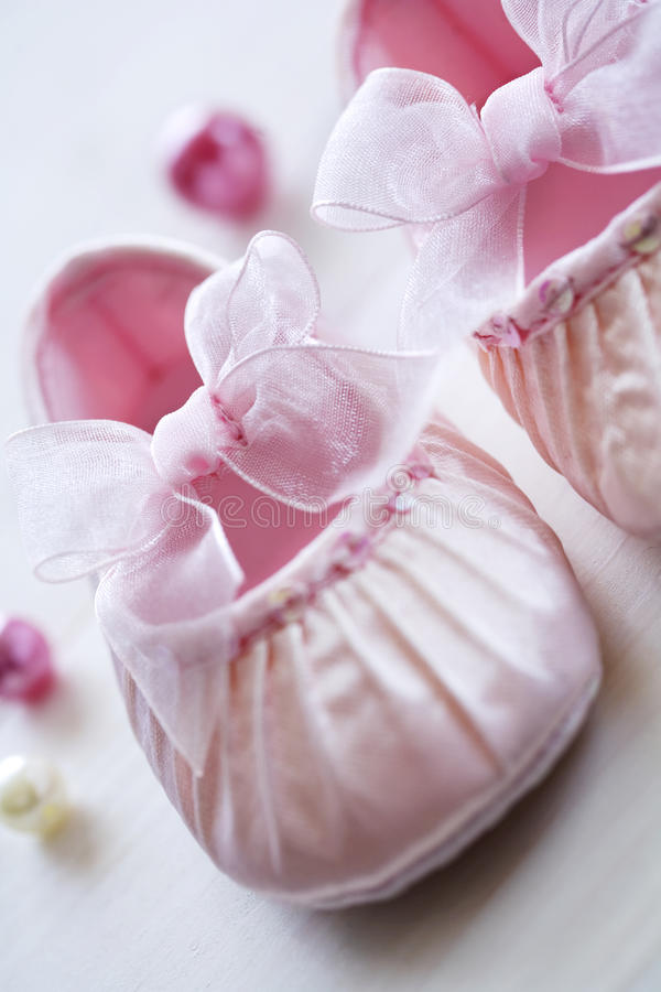 Babys satin shoes stock photography