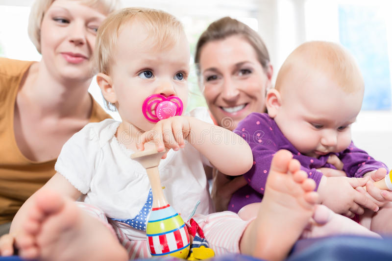 Babys in toddler group playing stock image
