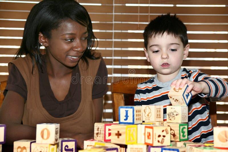 Babysitter stock fotografie