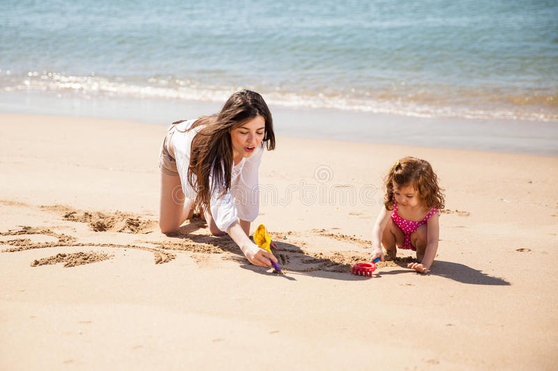 Babysitter at the beach stock image. Image of family - 51949581