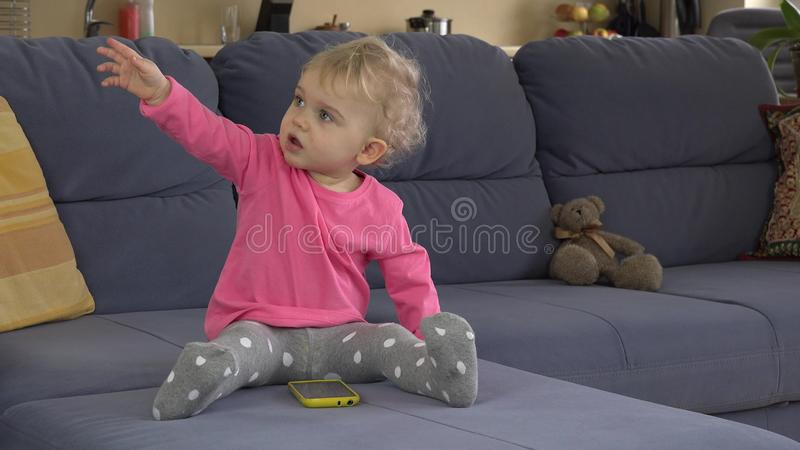 Babysitter Help Cute Baby Girl To Use Smart Phone Sitting On Sofa ...