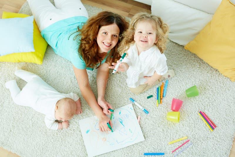 Babysitter with kids stock image. Image of happy, kindergarten ...