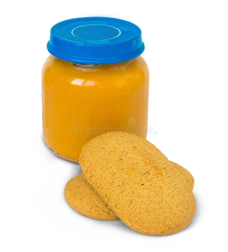 Babyvoedsel in kruik en koekjes, op wit stock fotografie