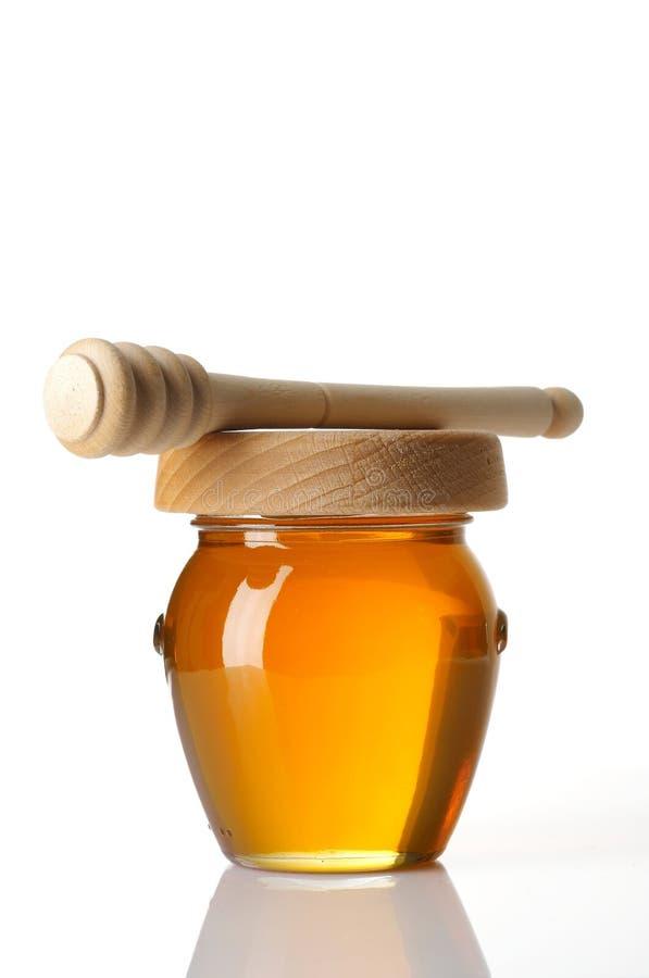 Bac de miel photographie stock