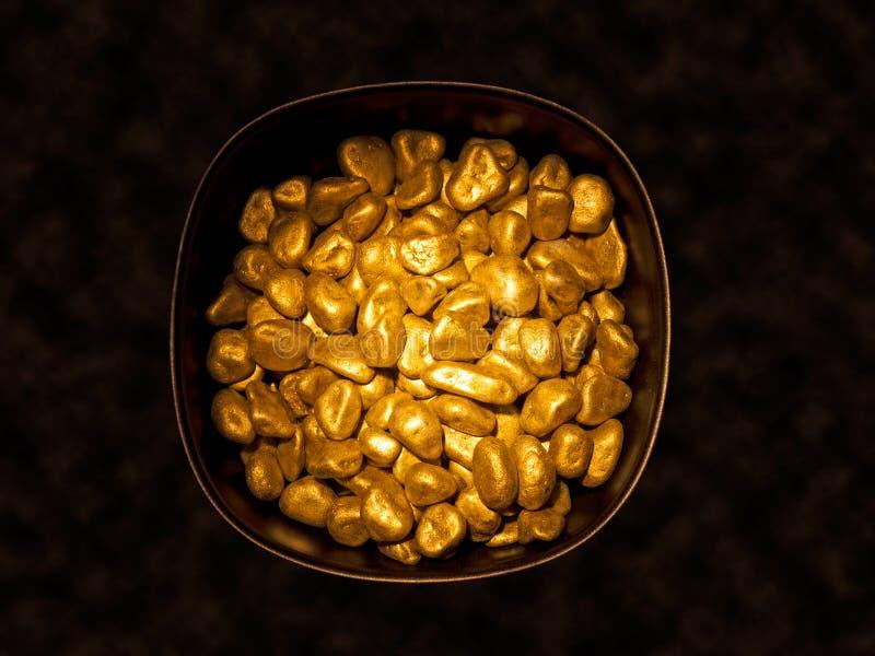 Bac de pépites d'or photographie stock