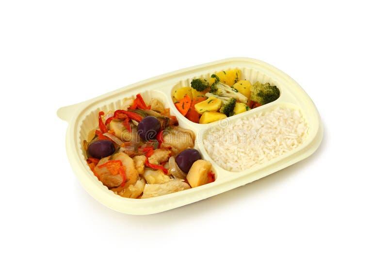 Bacalao un estilo portugués, un arroz y verduras cocidas al vapor imagen de archivo