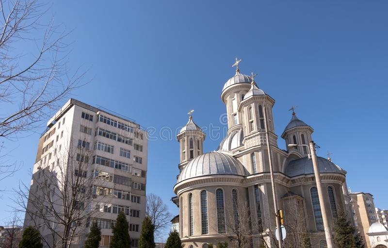 The orthodox church of the Holy Martyr Dimitrie against a bright blue sky, in Bacau, Romania. BACAU, Romania - March 23 2019: The orthodox church of the Holy royalty free stock images
