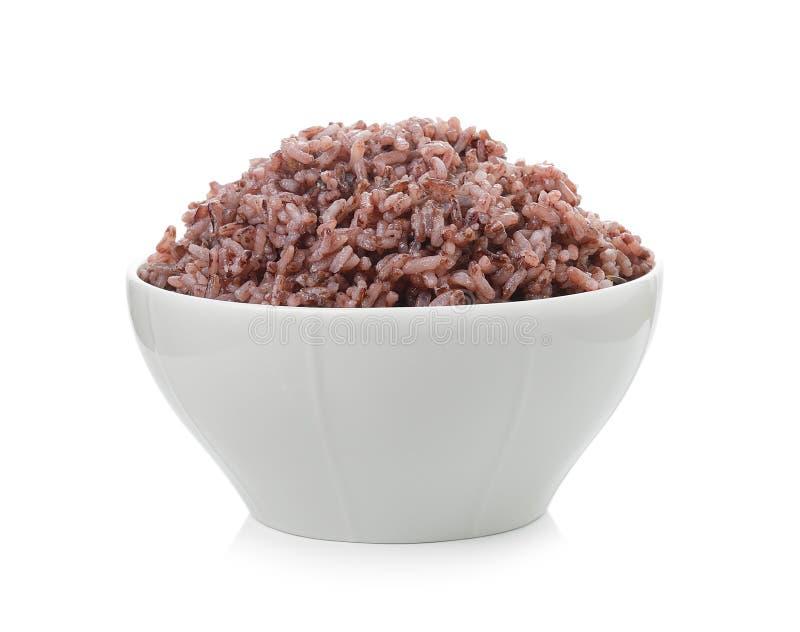 Bacca del riso in ciotola su fondo bianco fotografie stock libere da diritti