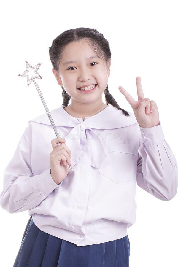 Bacchetta di magia della tenuta della ragazza dello studente fotografia stock