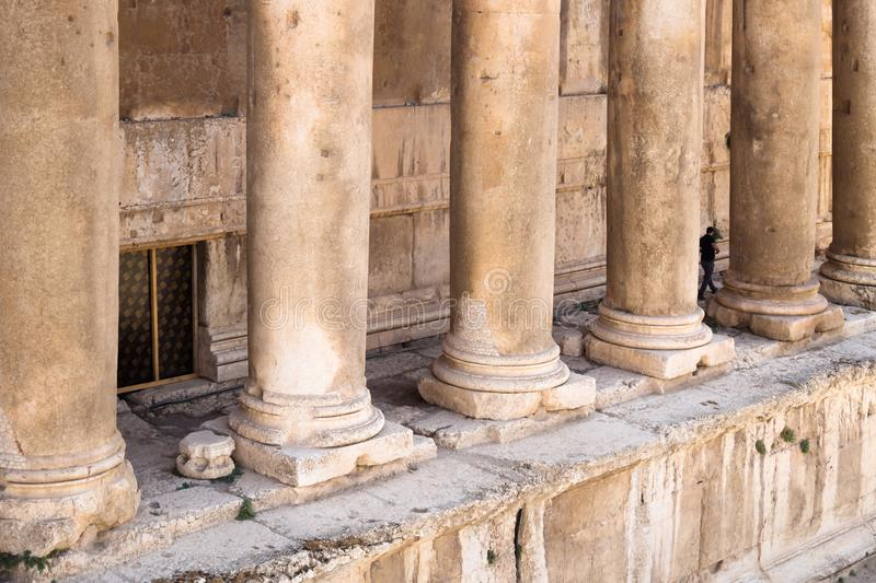 Baccus temple columns from high point of view, Baalbek, Lebanon. Baccus temple columns from high point of view with tourist going through, Baalbek, Lebanon stock photos
