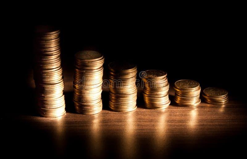 bacground czerń monety sterta zdjęcie royalty free